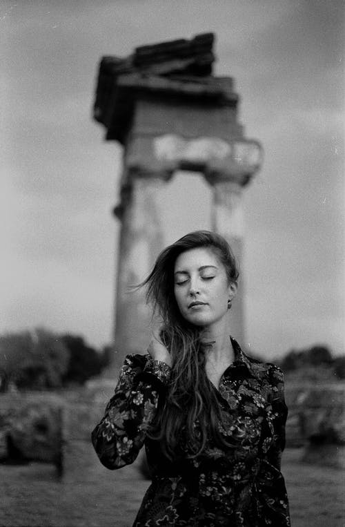 Grayscale Photo of Woman in Black and White Floral Dress