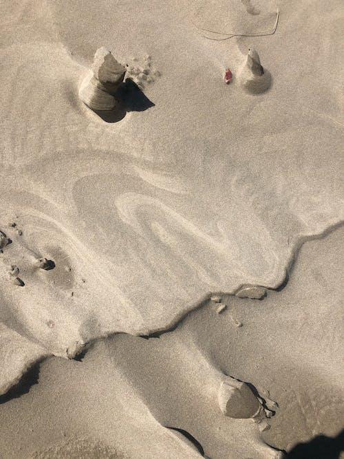 Sandy dunes with dry wavy terrain in desert