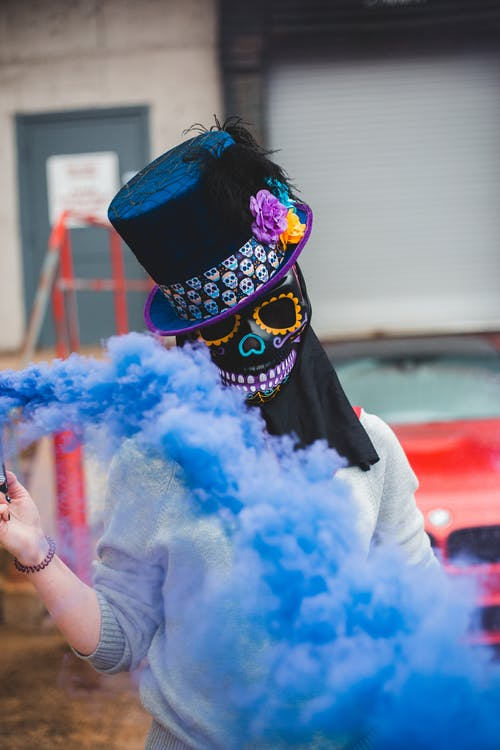 Anonymous woman in blue smoke