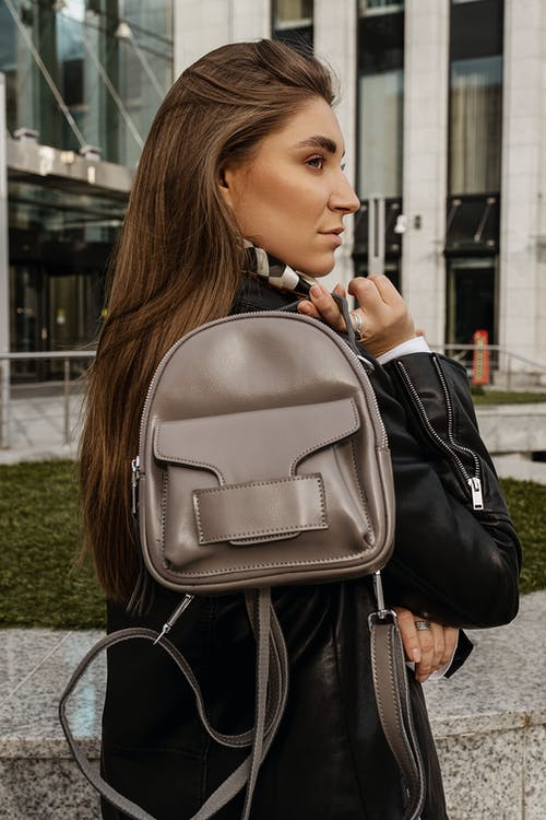 Woman in Black Leather Backpack