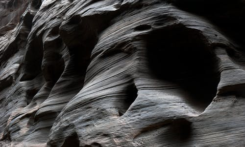 Gratis stockfoto met canyon, donker, duister, gaten