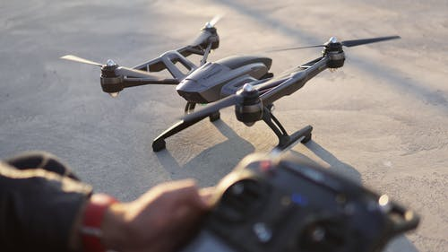 Drone and hand of crop person with remote control