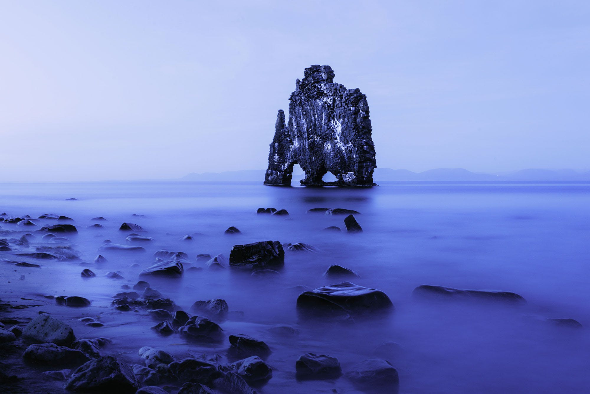 Rock Formation in Middle of Body of Water