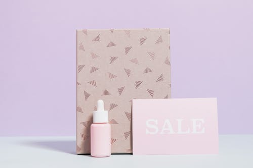 Healthcare Product In Pink Bottle With Printed Paper Bag On Sale