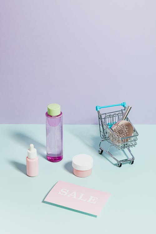 Shopping Cart Beside Cosmetic Products