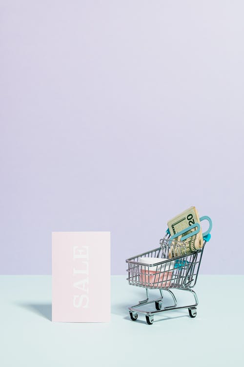 Money In A Mini Shopping Cart