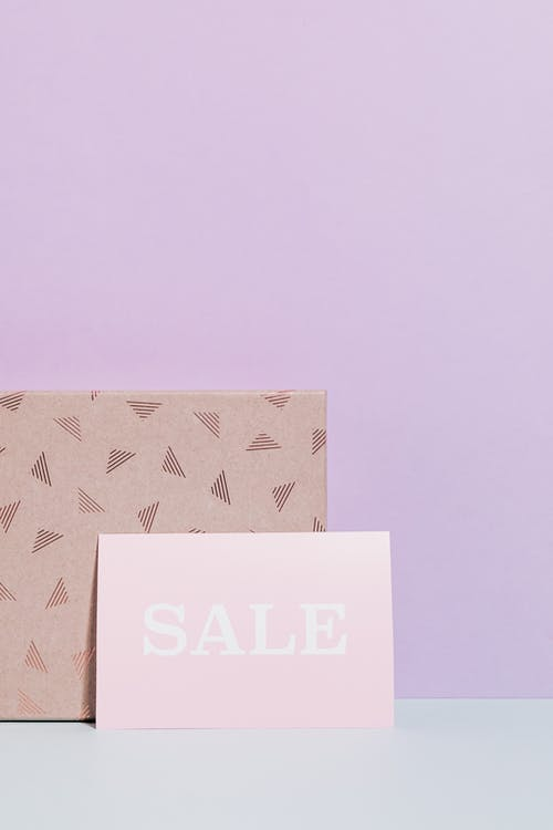 Sale Sign In Pink Paper