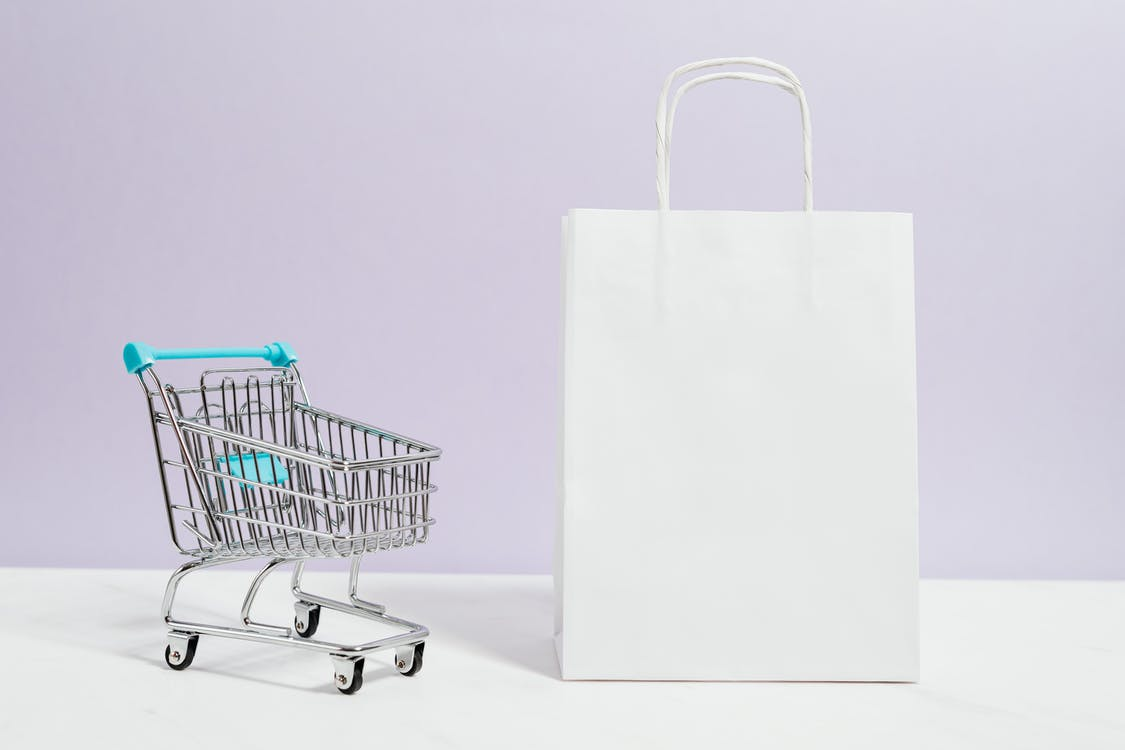 White Shopping Cart With White Paper