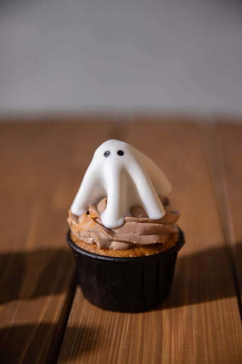 Cupcake with Ghost Topper on the Table