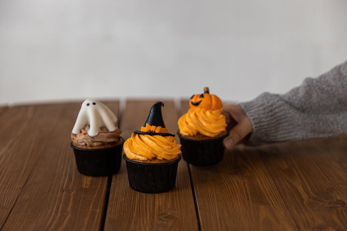 Cupcakes on Brown Wooden Table
