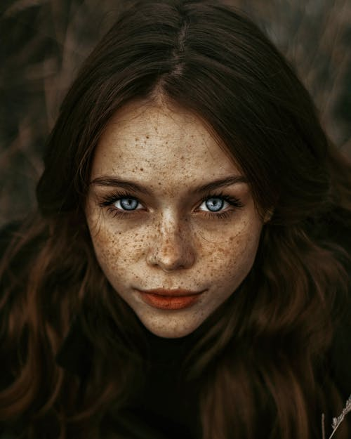 Beautiful woman with freckles on face