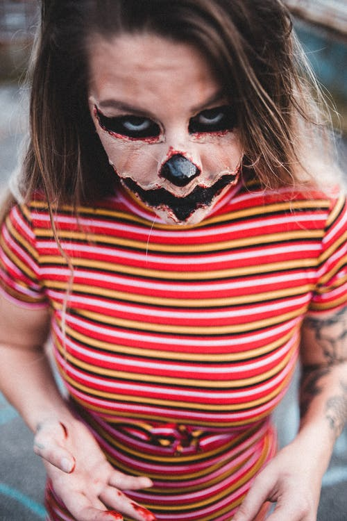 Young woman with scary makeup