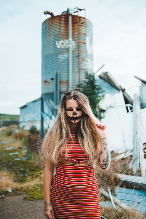 Woman with scary makeup on street