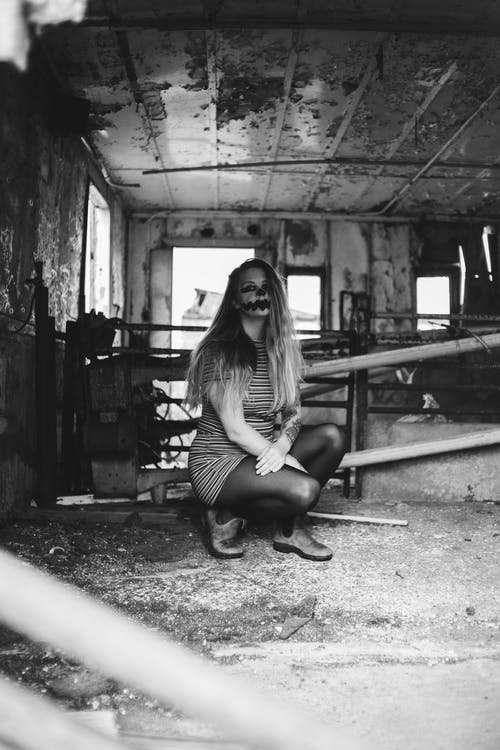 Woman with greasepaint in abandoned house