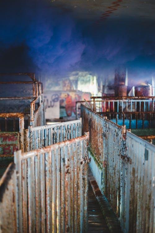 Metal rusty fences on street
