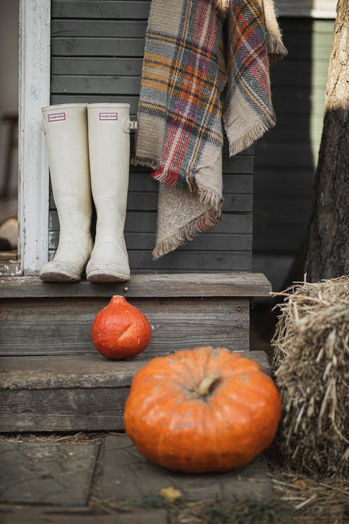 White Boots and Orange Pumpkin on the Stair