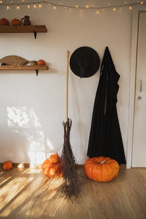 Witch Costume And Pumpkin In A Room