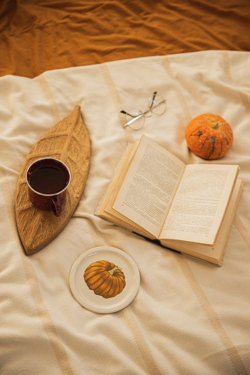 Book and Cup of Coffee on the Bed