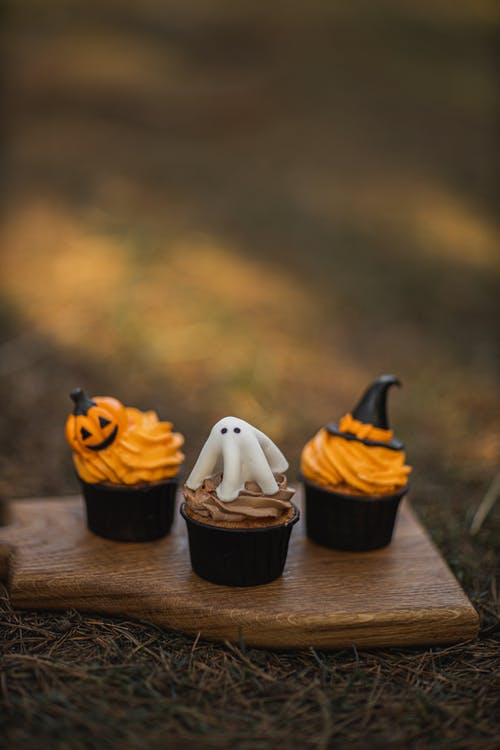 Halloween Cupcakes On Wooden Board
