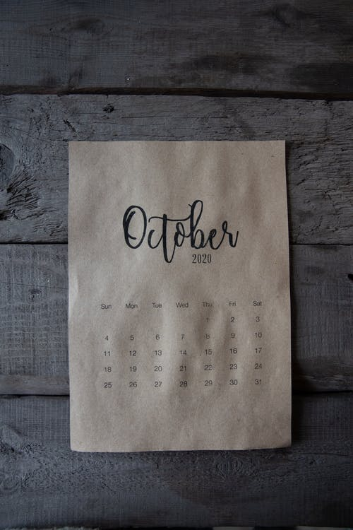 October Calendar On Wooden Surface