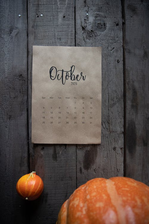 October Calendar on Wooden Wall