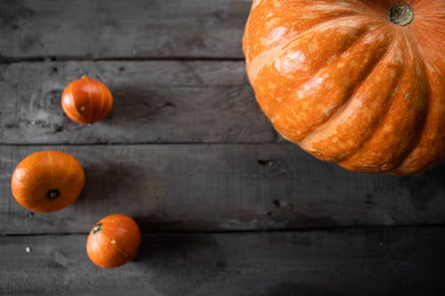 Orange Pumpkins on Brown Wooden Table
