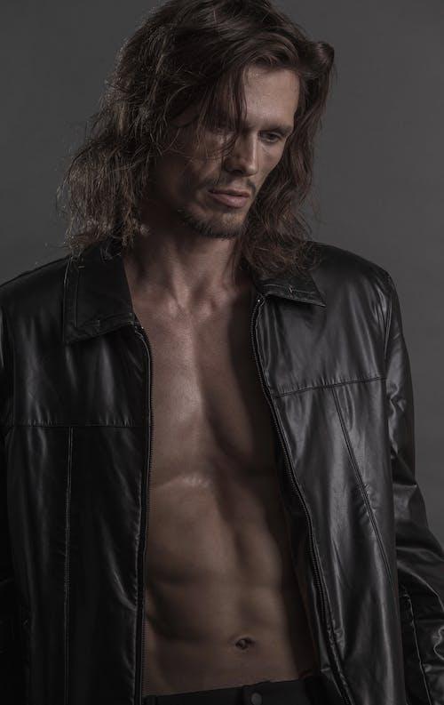 Topless Man Wearing Black Leather Jacket