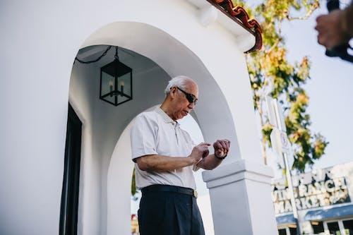Old Man Checking Time