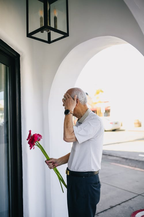 Old Man Holding Red Flowers