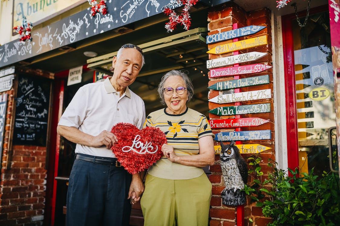 Elderly Couple Holding Red Heart