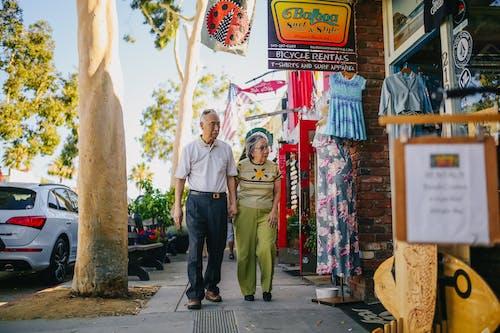 Elderly Couple Walking on the Street