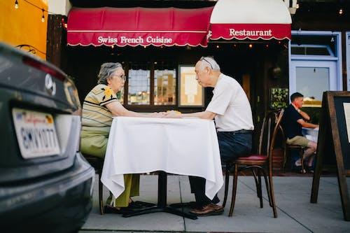 Elderly Couple Having Breakfast at the Restaurant
