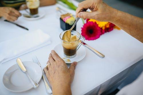 Person Stirring His Coffee