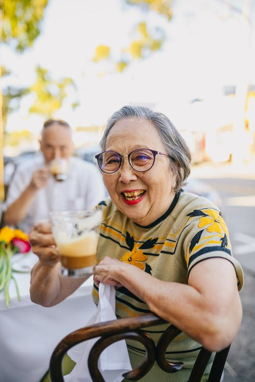 Smiling Elderly Woman While Drinking Chocolate