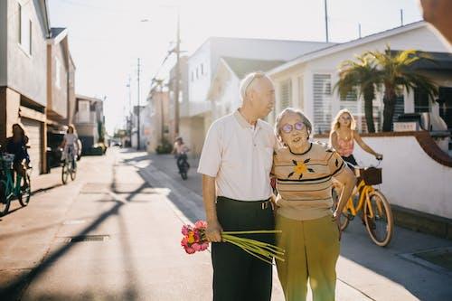 Elderly Couple Standing on the Street