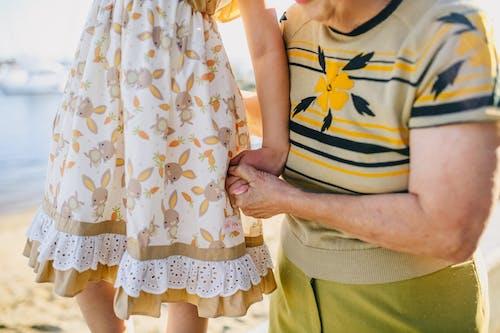 Grandma Holding Her Granddaughter While Walking