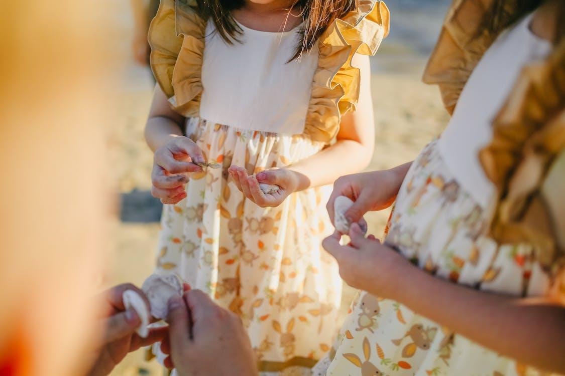 Girls Holding Seashells