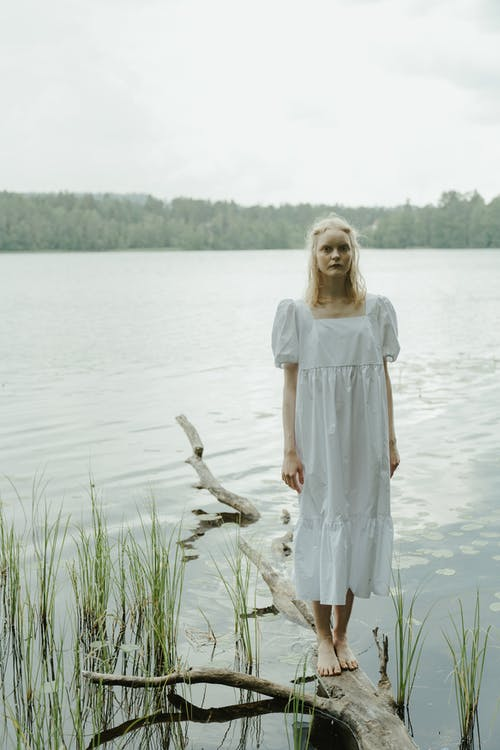 Girl in White Dress Standing on Water