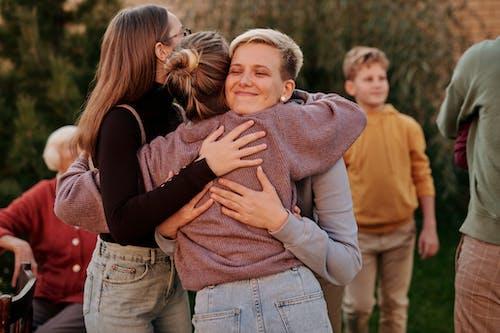 Woman in Brown Sweater Hugging Woman in Brown Sweater