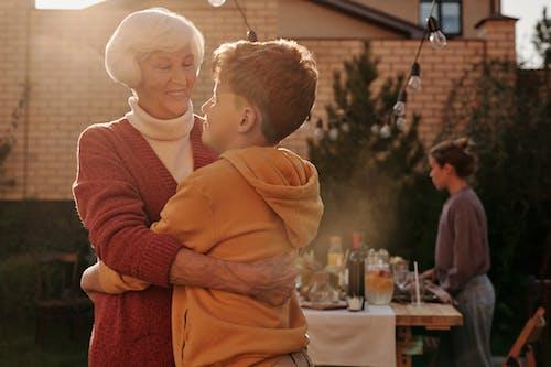 Elderly Woman Hugging Her Grandson
