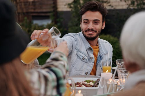 Cheerful man having dinner party with family