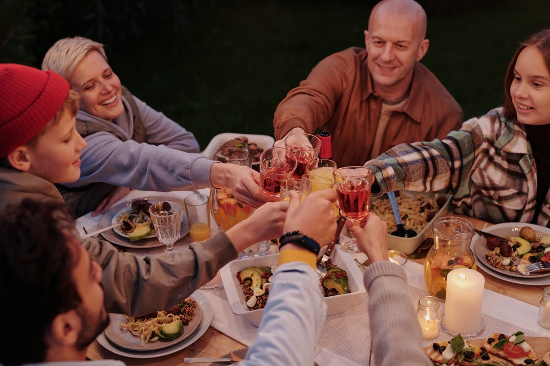 Cheerful family toasting during evening dinner