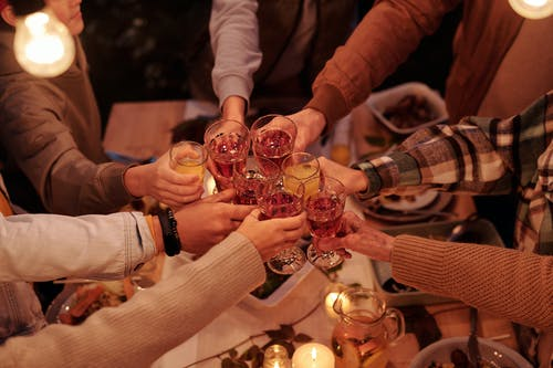 A Group of People Holding Glasses Doing a Toast