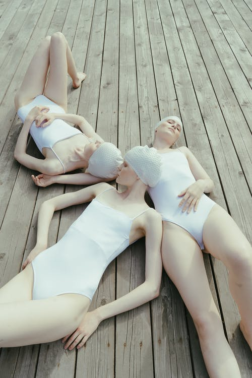 Women in Swimsuits Lying Down on the Floor