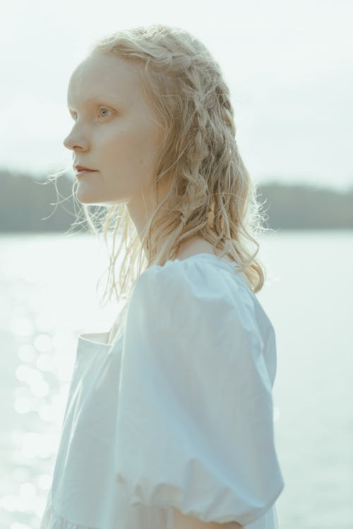 A Woman in White Shirt Looking Away