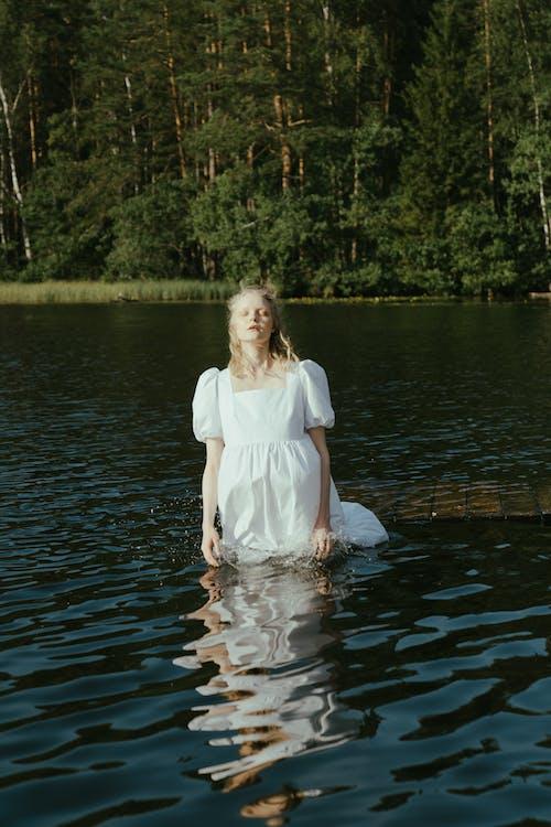 2 Women in White Dress Standing on Water