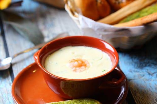 Creamy Soup in Red Ceramic Bowl