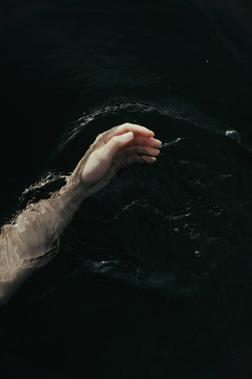 Persons Left Hand on Water