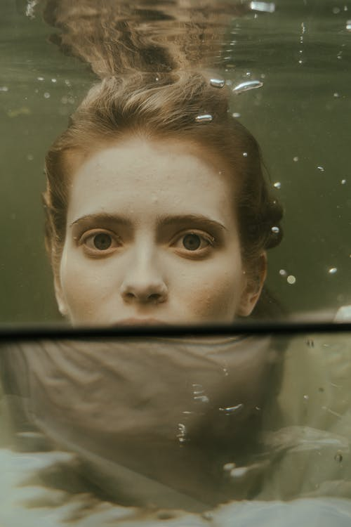 Womans Face on Glass