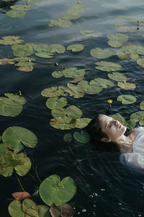 Woman in White Shirt on Water